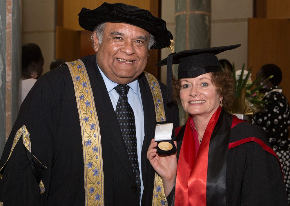 Chancellor Tom Calma with graduate Karel Williams and her medal