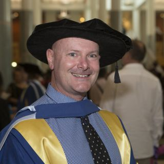 Dr Rob Stanton at his October 2015 graduation ceremony at Parliament House
