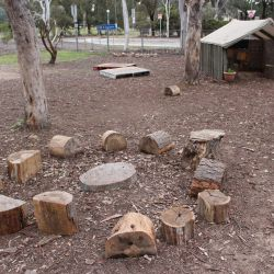 logs set out in a circle to encourage children to sit and share stories