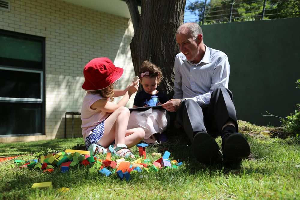 Professor Tom Lowrie and two preschoolers explore a tablet-based app and play with blocks