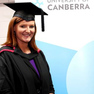 Image of Katie Toleafoa with her law degree