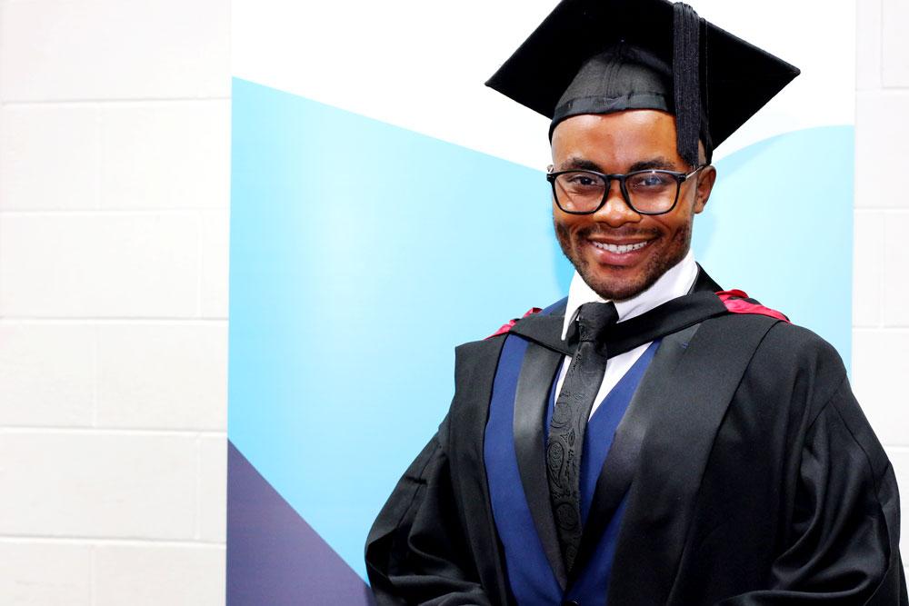 Monga Mukasa with his University of Canberra degree
