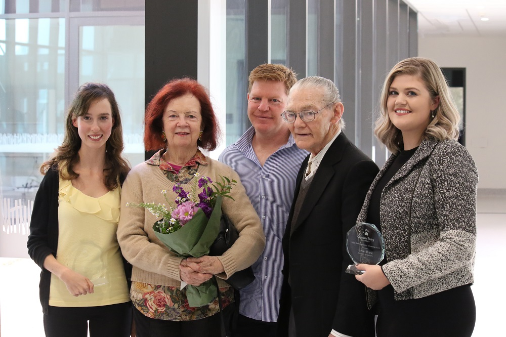 Ms Mitterfellner (far left) and Ms Drane (far right) with the Robberds family, grandmother Sandra, grandfather Lionel and father Craig. Sandra and Lionel flew in from Sydney just for the scholarship ceremony. Photo: John Masiello