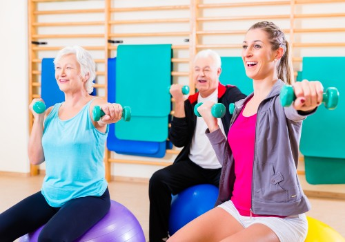 Two women on exercise balls using free wrights in a session at the Cancer Wellness Centre in UC Health Clinics Specialist Medical Centre
