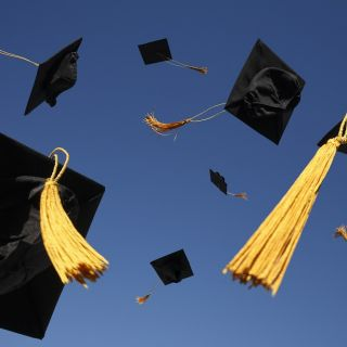 grad hats in air