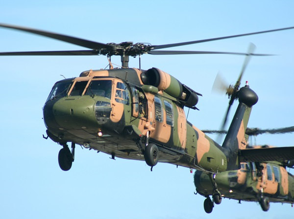 A pair of Australian Army blackhawk helicopters, painted in camouflage