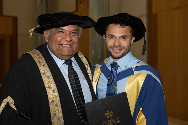 Raglan Maddox with UC Chancellor Professor Tom Calma following Dr Maddox's graduation