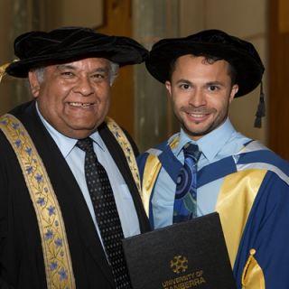 Raglan Maddox with UC Chancellor Professor Tom Calma following Dr Maddox's graduation