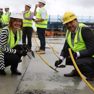 UC Public Hospital cements construction milestone