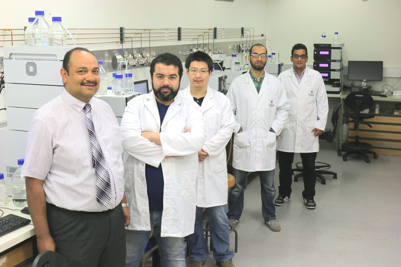Dr Ashraf Ghanem and his research team stand in their laboratory