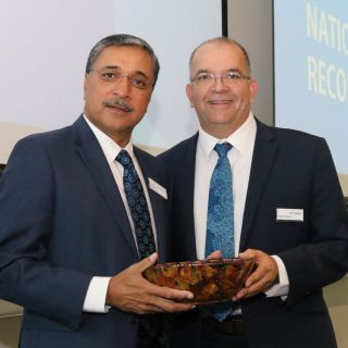 The Dean of Aboriginal and Torres Strait Islander Leadership and Strategy, Professor Peter Radoll, presents the Vice-Chancellor and President, Professor Deep Saini, with a wooden bowl that represents the unbreakable commitment from the University to reconciliation.