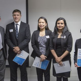 Minister Shane Rattenbury (left) congratulates UC students Phillip MacDougall, Karen Muga, Kirandeep Goraya and Janet Johnson on their Univative Canberra Challenge project win