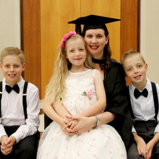 UC graduate Tanya Stiller with her three children