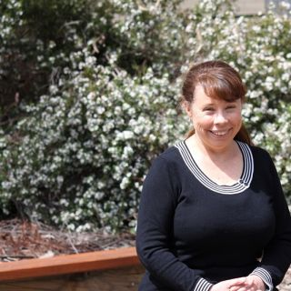 Dr Janine Deakin poses for a profile photo in a garden at the University of Canberra