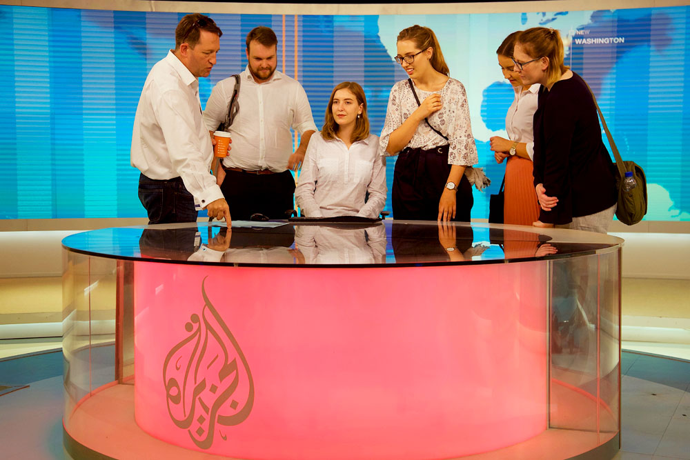 Al Jazeera English presenter Adrian Finighan giving the 2017 AMEJE delegates a tour of the studio