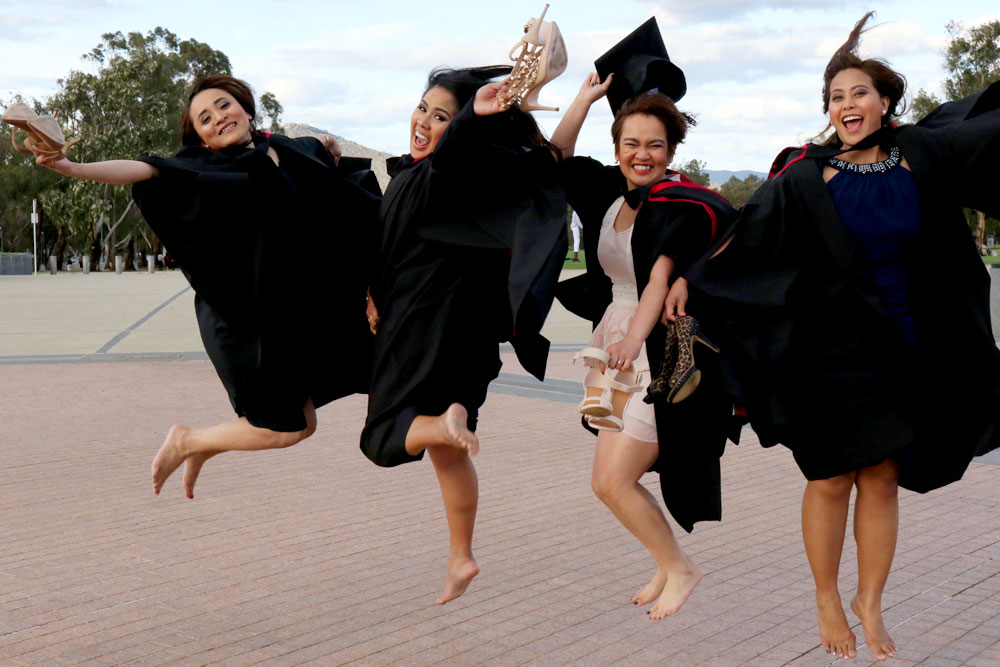 Students celebrate their graduations at Parliament House