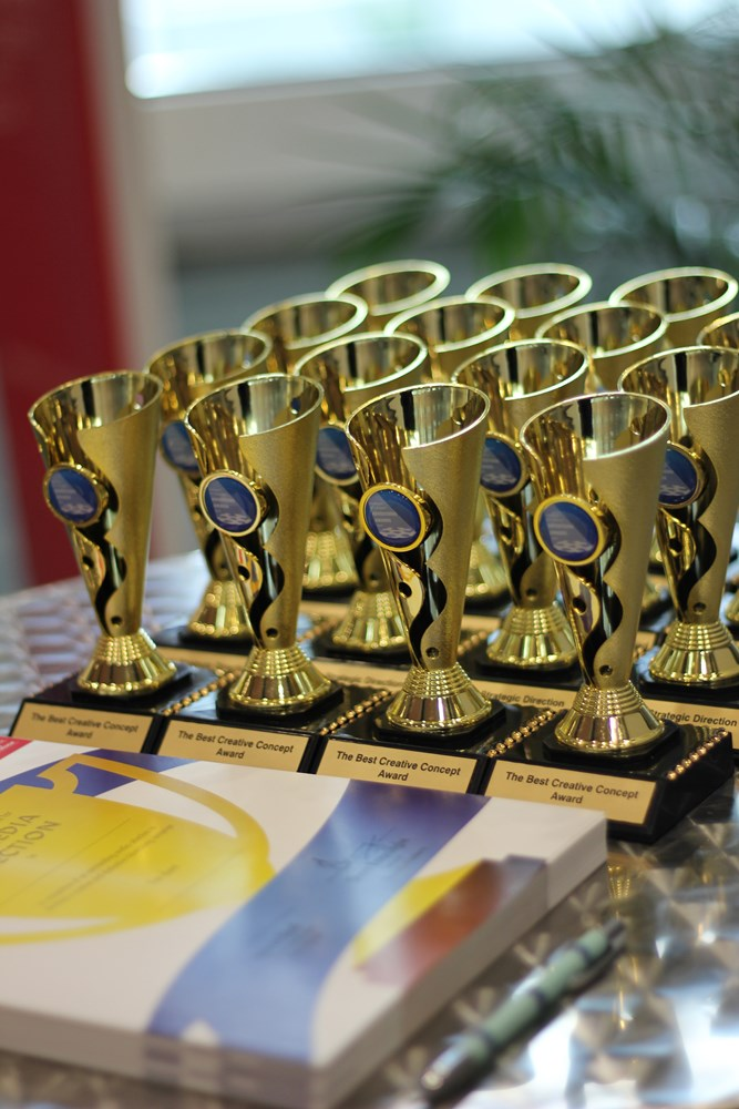 A collection of trophies for the 2017 UC Advertising Awards
