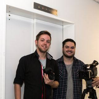 Film production students Cameron Griffith and James Christie-Murray standing in front of an elevator