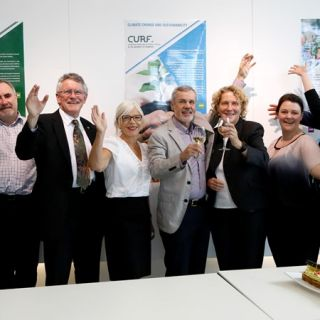Members of the CURF team celebrate the recent birthday of their group