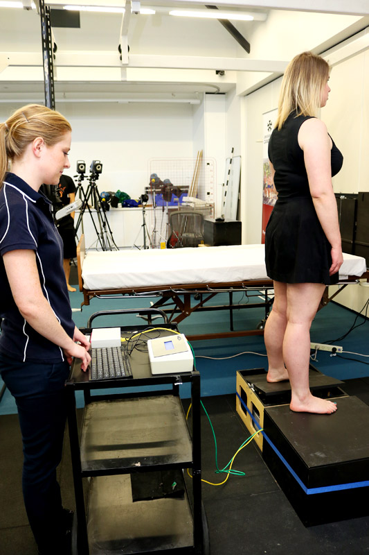 Bachelor of Physiotherapy Honours student Ashleigh Marchant tests research volunteer Amy's sense of proprioception