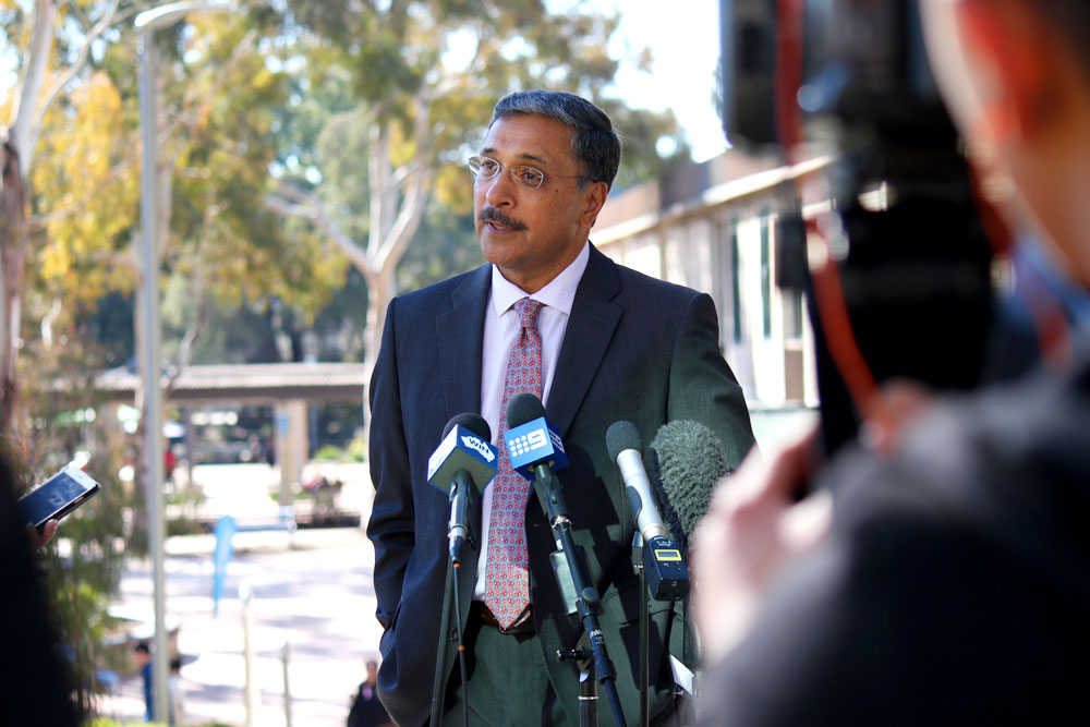 UC Vice-Chancellor Professor Deep Saini addresses journalists and cameras at the University of Canberra