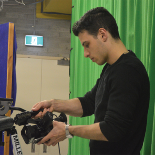 UC film production student Jordan Devitre filming 'Through My Eyes' in the TV studio on campus