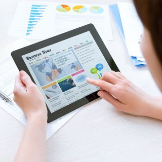 Image of woman accessing news on a digital device