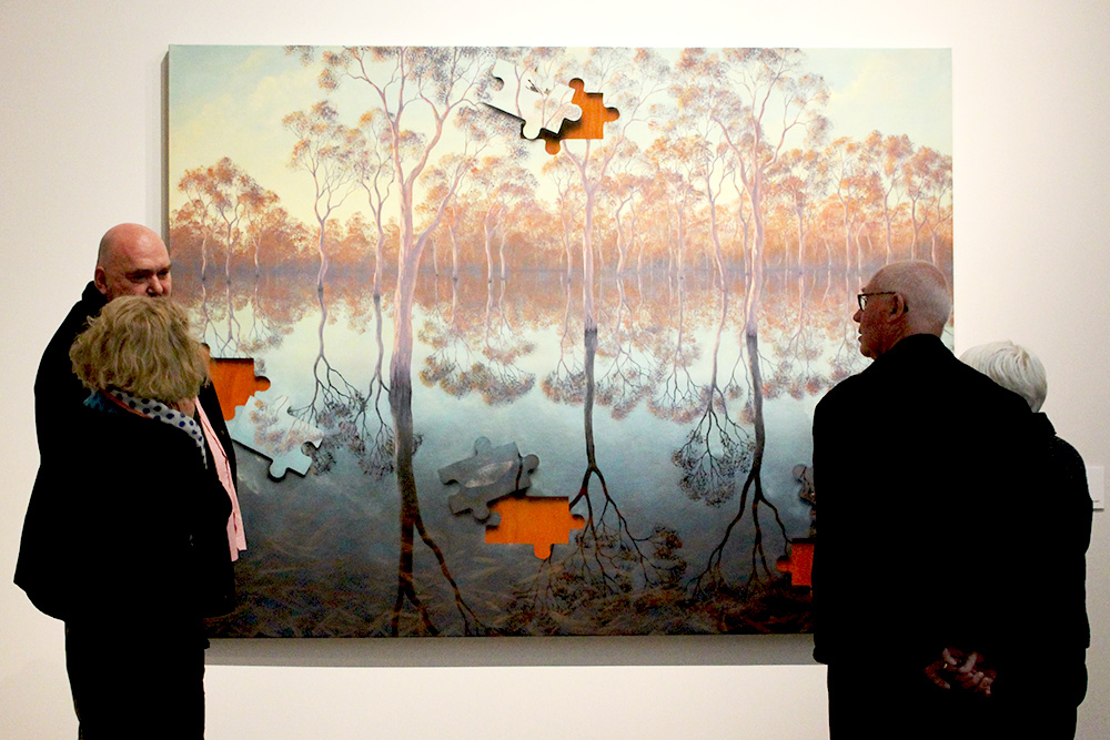 Dementia and Art Program participants examine a painting at the National Gallery of Australia