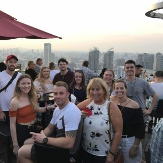 Greg Bullock (far left) and some of his fellow international interns from the University of Canberra, enjoying a rooftop view in Singapore.