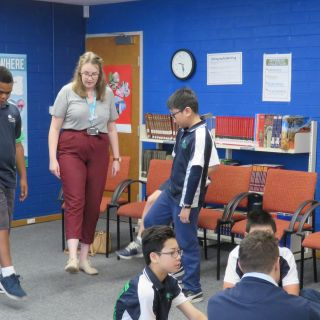 Preservice teachers exercising with Year 6 children at the launch of the Affiliated Schools Program