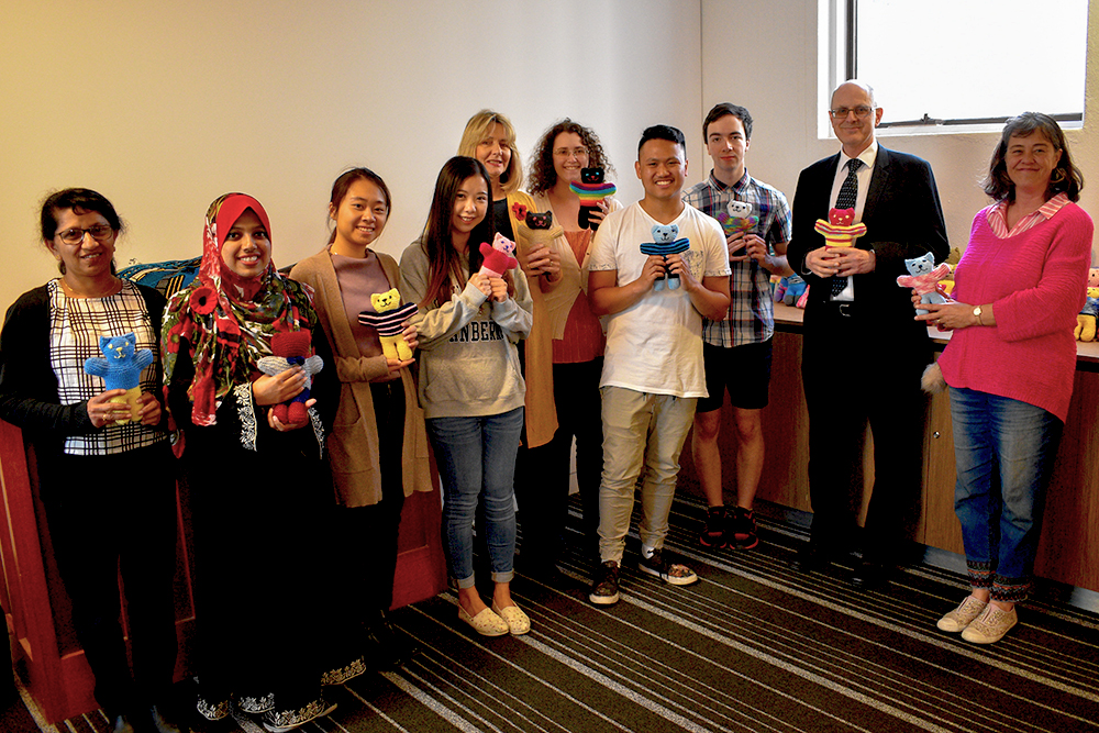 UC students hand over the teddies to the Australian Red Cross