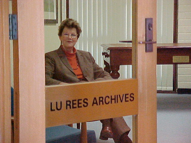 Dr Belle Alderman, AM, at the door to the Lu Rees Archives.