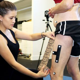 Bachelor of Physiotherapy (Honours) student Nicky Robinson applies markers to a participant for her research on using sports tape to ease hip pain in women