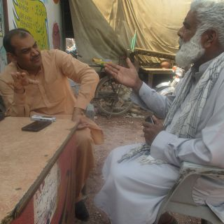 Nadeem Akmal in Pakistan chatting to a farmer