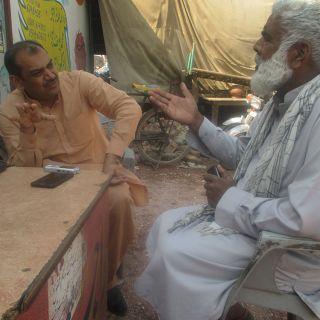 Nadeem Akmal in Pakistan chatting to a farmer