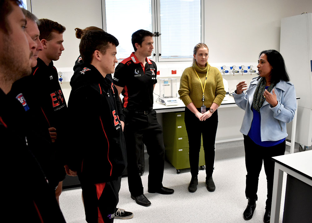 Eastlake Demons players tour the Melanie Swan Memorial Translational Centre