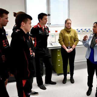 Eastlake Demons players tour the Melanie Swan Memorial Translational Centre