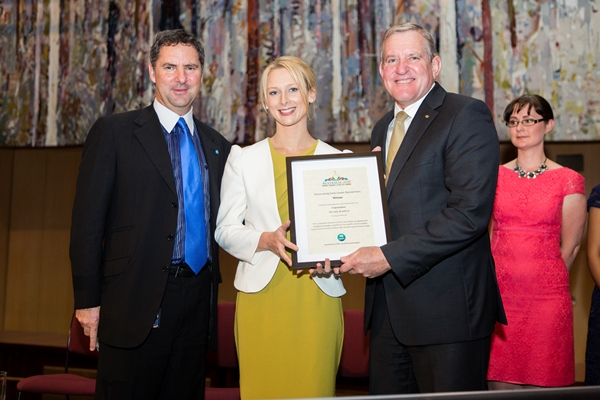 Early Career Researcher of the Year winner Sally Bradford accepting her award from the Federal Minister for Industry and Science Ian McFarlane