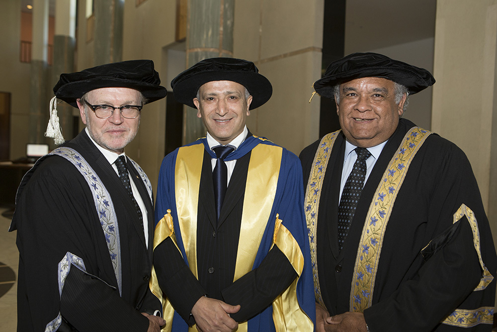 photo of Vice-Chancellor Professor Stephen Parker AO, Dr Jamal Rifi, Chancellor Professor Tom Calma AO at the University of Canberra graduation ceremony. Photo by Michelle McAulay