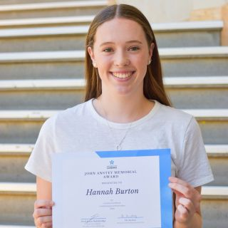 Hannah with certificate