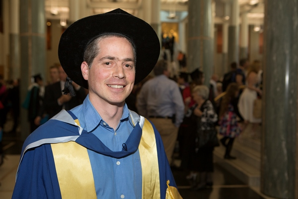 Dr Bruno de Oliveira Ferronato in his graduating gown and bonnet at Parliament House