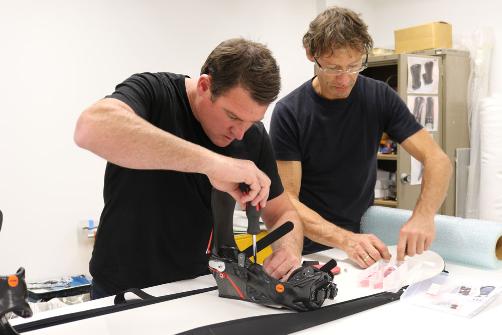 L-R: Ben Wordsworth and Bill Shelley fit the new bindings on a snowboard