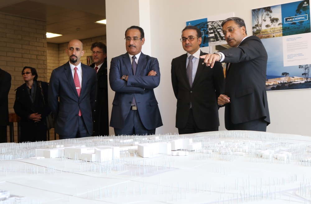 Professor Deep Saini shows the Kuwaiti Delegation a model of the University of Canberra