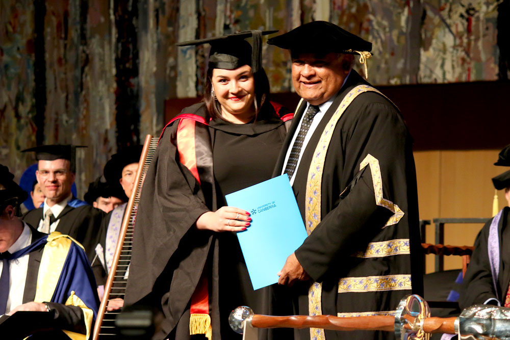 Alice receiving her degree from her father Tom