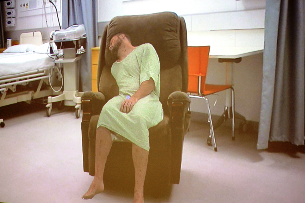 The HoloPatient avatar on a chair in the nursing teaching lab