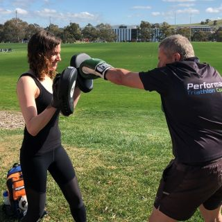 Researcher Katie Speer and participant Martin, spar during the boxing training