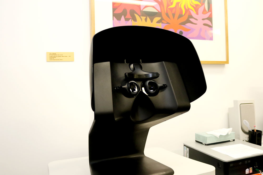 The device, developed in Canberra tests a person's eye response to small flashes of light to assess their eye function.