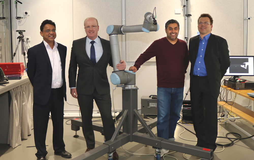 Photo of Dr Lakmal Seneviratne from Khalifa University Robotics Institute, Scott Russell from Tactical Research, and Dr Damith Herath and Dr Roland Goecke from the University of Canberra.
