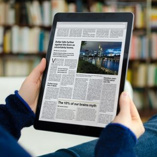 Lady reading news on ipad