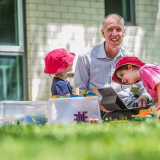 Tom Lowrie with early learning students